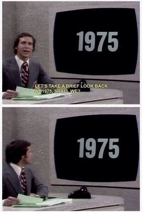 """Chevy Chase literally turning and looking back at a screen that says """"1975"""""""