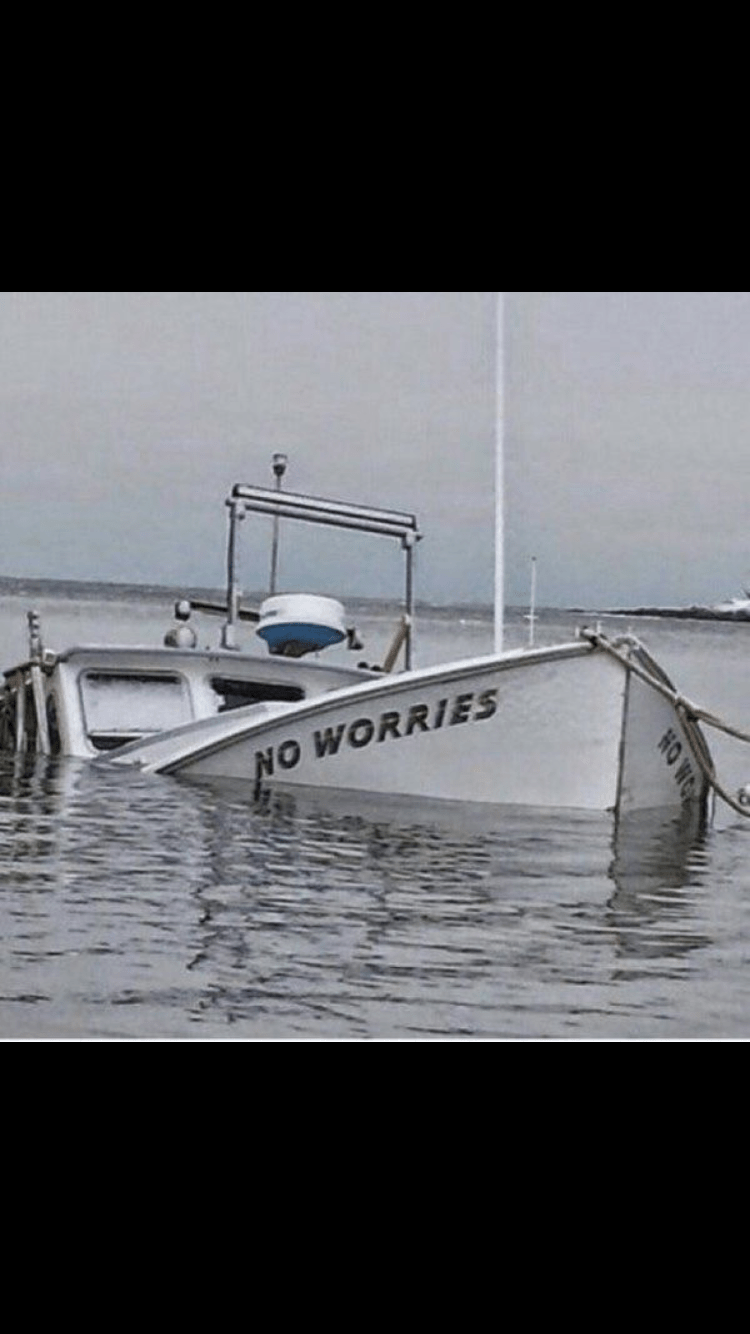 wholesome meme of a sinking boat that has no worries written on the sides of the boat