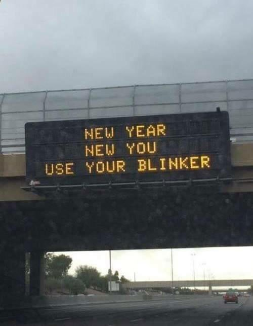 "Pic of a sign on the freeway that reads, ""New year, new you, use your blinker"""