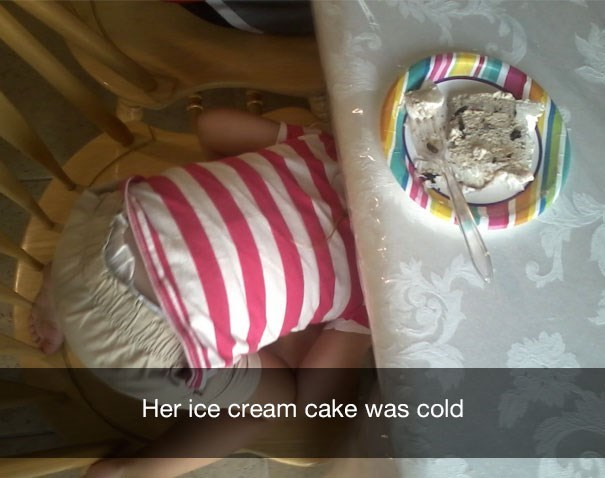"Snapchat text that reads, ""Her ice cream cake was cold"" over a pic of a small child hiding under a table with a slice of ice cream cake on a plate"