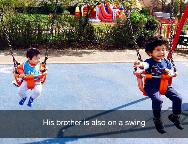 Child - His brother is also on a swing