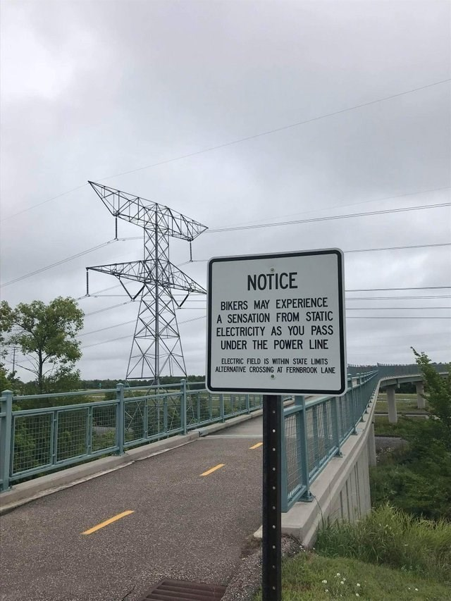 Road - NOTICE BIKERS MAY EXPERIENCE A SENSATION FROM STATIC ELECTRICITY AS YOU PASS UNDER THE POWER LINE ELECTRIC FIELD IS WITHIN STATE LIMITS ALTERNATIVE CROSSING AT FERNBRO0OK LANE