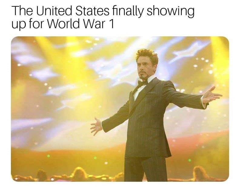 """Caption that reads, """"The United States finally showing up for World War I"""" above a pic of Tony Stark on stage appearing to hype up the crowd"""