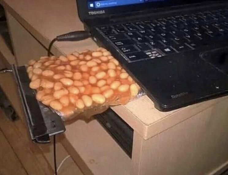 cursed image - Food - TOSHIBA disk player filled with beans