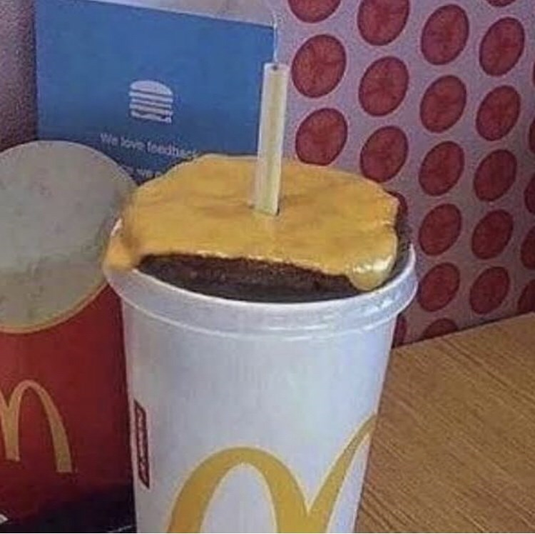 cursed image - McDonald's cup with cheeseburger in drink
