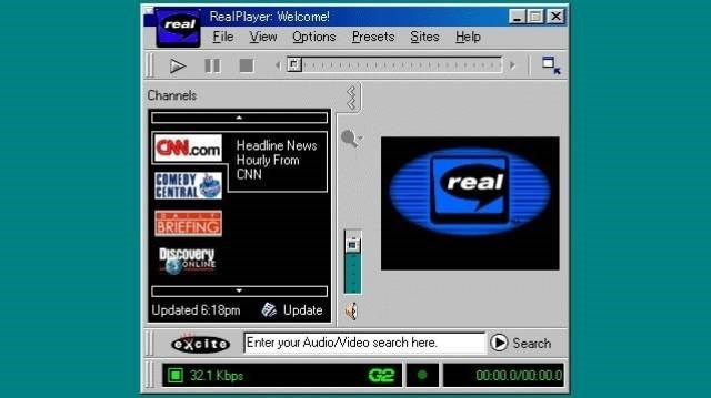 Text - X RealPlayer: Welcome! real File View Options Presets Sites Help Channels Headline News Hourly From CNN CAN.com COMEDY CENTRAL real BRIEFING DISCOvery ONLINE Updated 6:18pm Update oXcito Enter your AudioVideo search here. Search 00:00.0/0000.0 32.1 Kbps