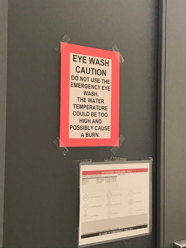 Text - EYE WASH CAUTION DO NOT USE THE EMERGENCY EYE WASH. THE WATER TEMPERATURE COULD BE TOO HIGH AND POSSIBLY CAUSE A BURN. AUTHORIZED PERSONNEL ONLY IN CASE OF EMERGENCY CALL 911