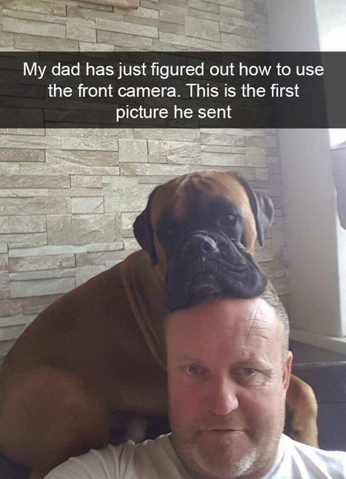 """Pic of a boxer resting his head on a guy with Snapchat caption that reads, """"My dad has just figured out how to use the front camera. This is the first picture he sent"""""""