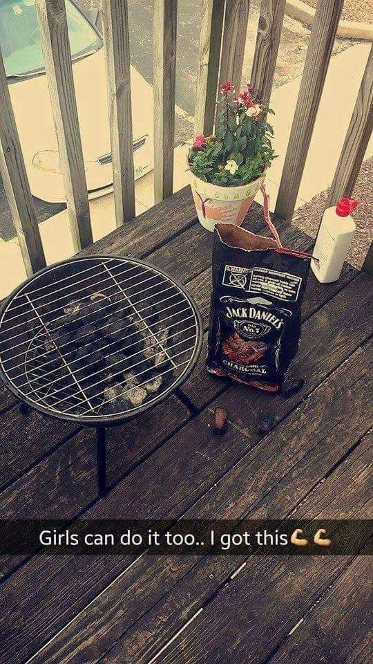 """Pic of a grill next to a bag of charcoal with Snapchat text that reads, """"Girls can do it too...I got this"""""""