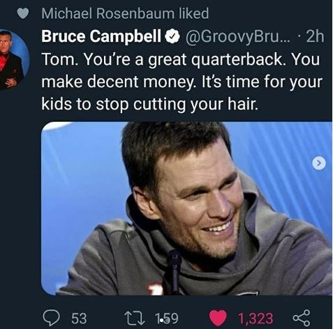 """Tweet that reads, """"Tom. You're a great quarterback. You make decent money. It's time for your kids to stop cutting your hair"""" above a pic of Tom Brady with a terrible haircut"""