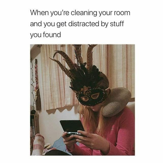 """Caption that reads, """"When you're cleaning your room and you get distracted by stuff you found"""" above a pic of a woman wearing a fancy mask playing on her phone"""