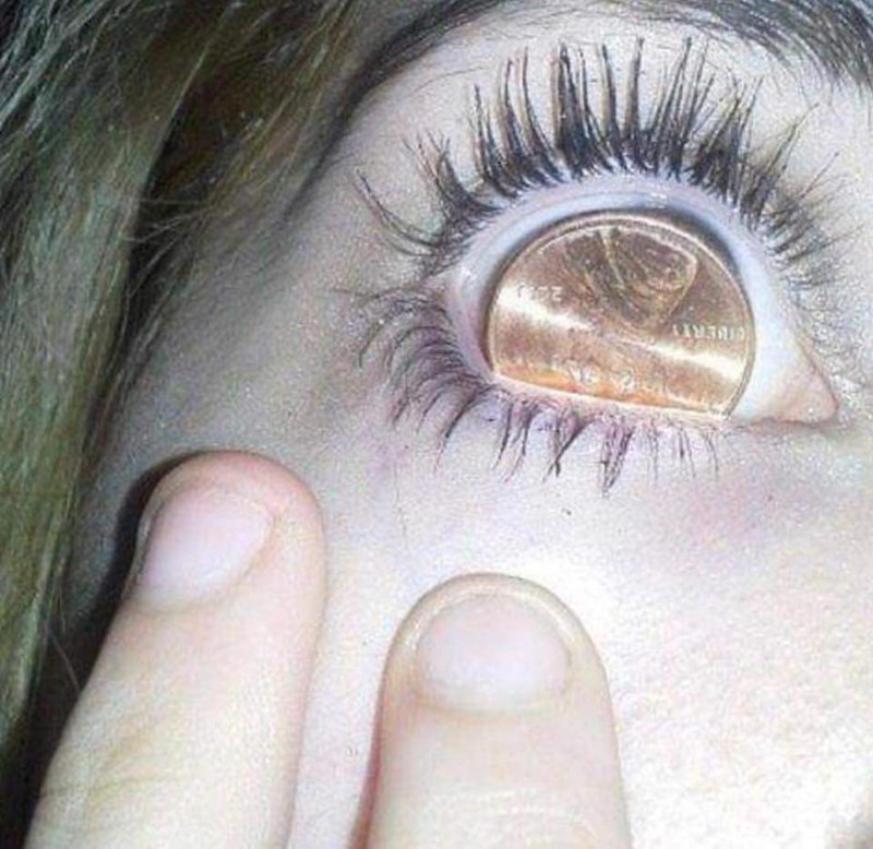 cursed_image - Face - 24 coin in eye