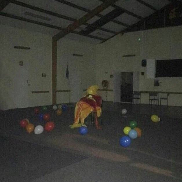 cursed_image- dark room with balloons