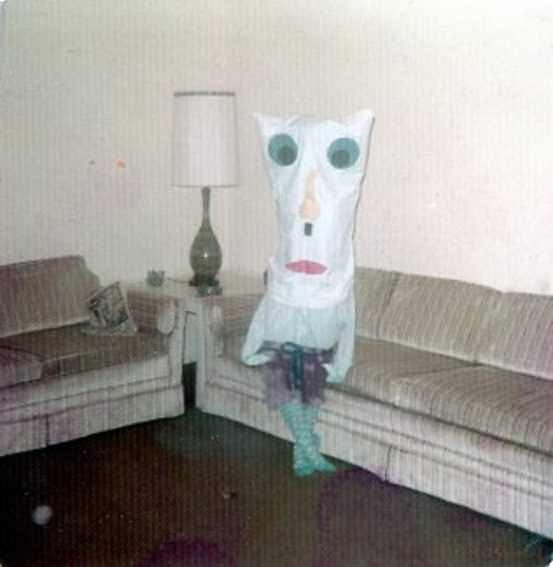cursed_image - Room with weird creepy costume