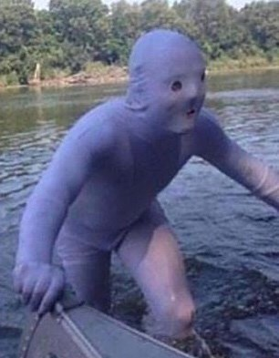 cursed_image - Organism man in purple costume in water