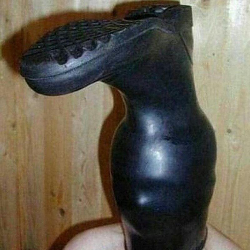 cursed_image - boot on a humans head