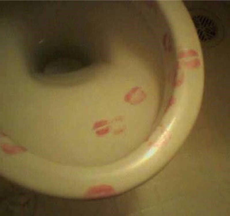 cursed_image-lipstick kisses on a toilet seat