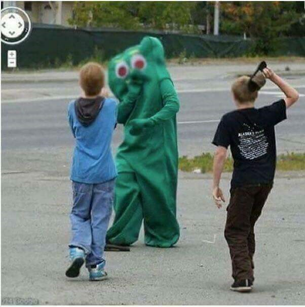 cursed_image-kids hitting a person in a costume