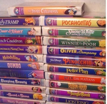 Text - AThree Caballeros POCAHONTAS SnowyWaite dyTRAMP Dear Heart WINNIE POOH ack Cauldron OLIVER Company NHICNee DME PINOCCHIO MelodyTime DUMBO Peter Pan N DALMATIANS Steeping Beauty ROBIN HOOD JungleBook The Sund & Srone LION ING May Ppin