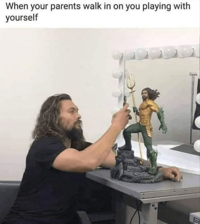 "Caption that reads, ""When your parents walk in on you playing with yourself"" above a pic of Jason Momoa playing with an Aquaman figurine"