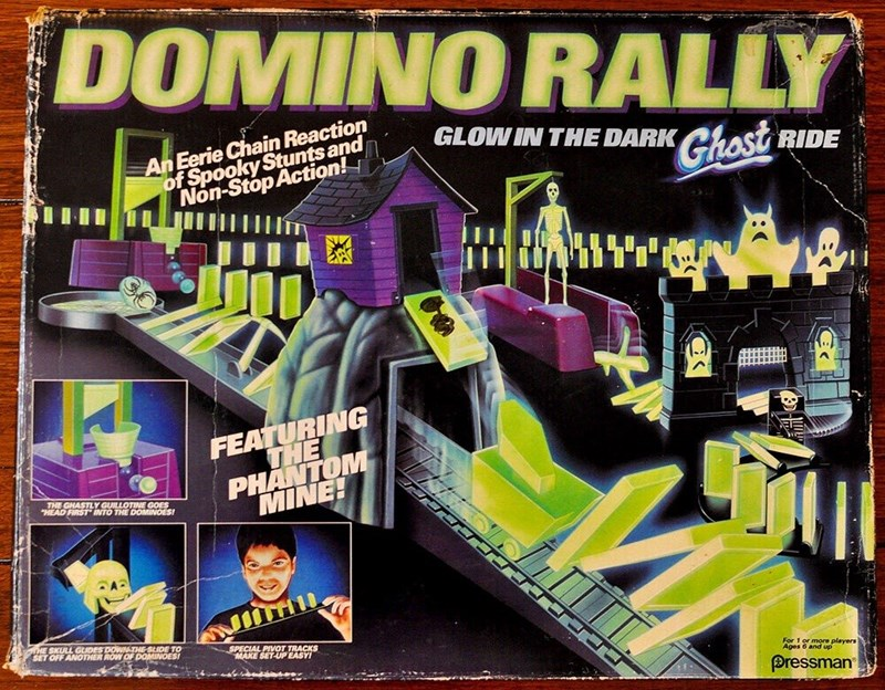 """nostalgia - Fictional character - DOMINO RALLY An Eerie Chain Reaction of Spooky Stunts and Non-Stop Action! GLOW IN THE DARK Ghost RIDE FEATURING THE PHANTOM MINE! E THE GHASTLY GUILLOTINE GOES """"HEAD FIRST INTO THE DOMINOES WHE SKULL GUIDES DOWN THE-SLIDE TO SET OFF ANOTHER ROW OF DOMINOES! SPECIAL PIVOT TRACKS MAKE SET-UP EASYI For 1 or more players Ages 6 and up Pressman"""