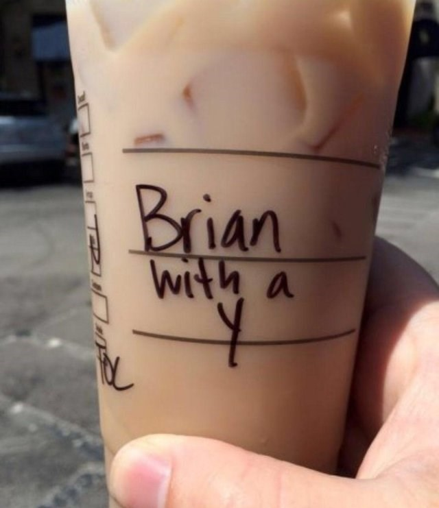 hand holding iced coffee cup with Brian with a y written on it