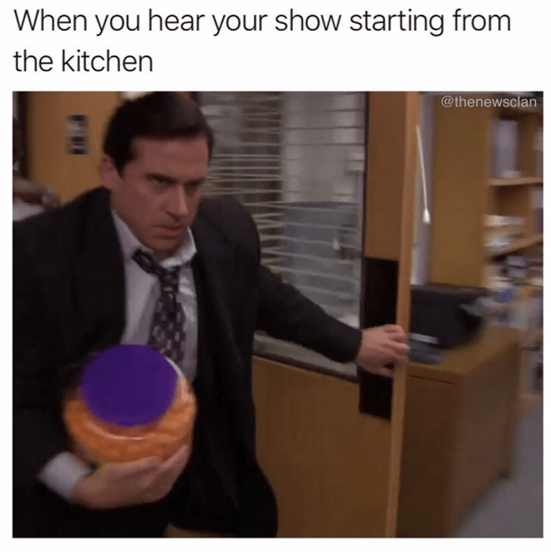 the office meme with michael running with food and when you hear the show starting from the kitchen