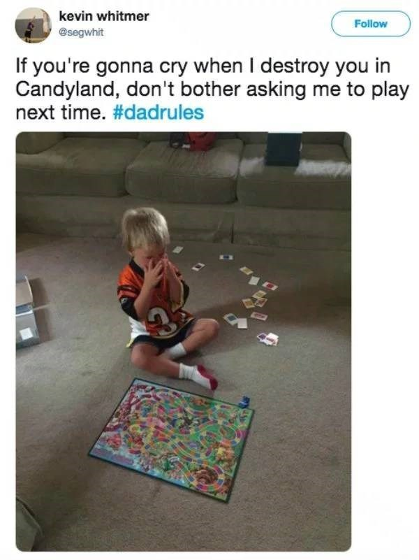 """Tweet that reads, """"If you're gonna cry when I destroy you in Candyland, don't bother asking me to play next time. #dadrules"""" above a pic of a toddler crying after being beat at CandyLand"""