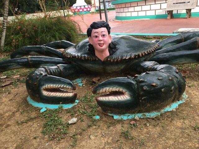 cursed image - creepy sculpture boy as a crab