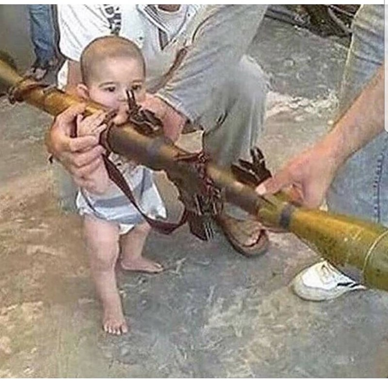cursed image - Child holding a weapon
