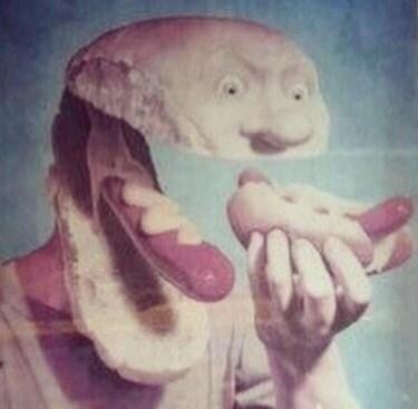 cursed image - bun head eating hotdog