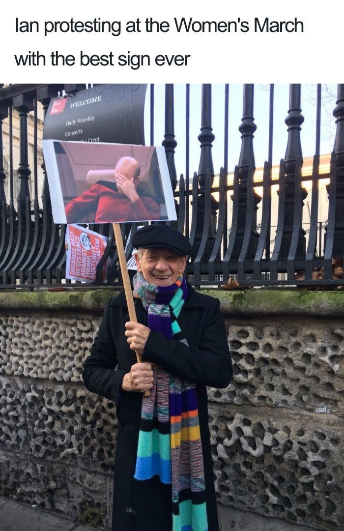 Photography - lan protesting at the Women's March with the best sign ever WELCOME Daily Worship Concerts Crypt
