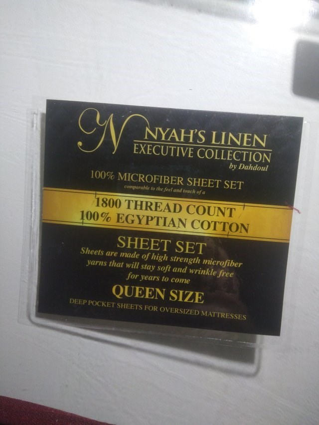 Text - NYAH'S LINEN EXECUTIVE COLLECTION by Dahdoul 100% MICROFIBER SHEET SET comparable to the feel and touch of a 1800 THREAD COUNT 100% EGYPTIAN COTTON SHEET SET Sheets are made of high strength microfiber yarns that will stay soft and wrinkle free for years to come QUEEN SIZE DEEP POCKET SHEETS FOR OVERSIZED MATTRESSES