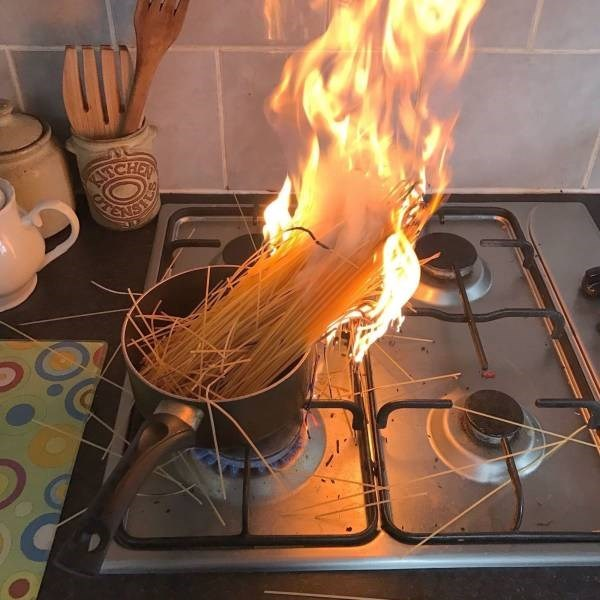 Pic of some spaghetti cooking on a stove on fire