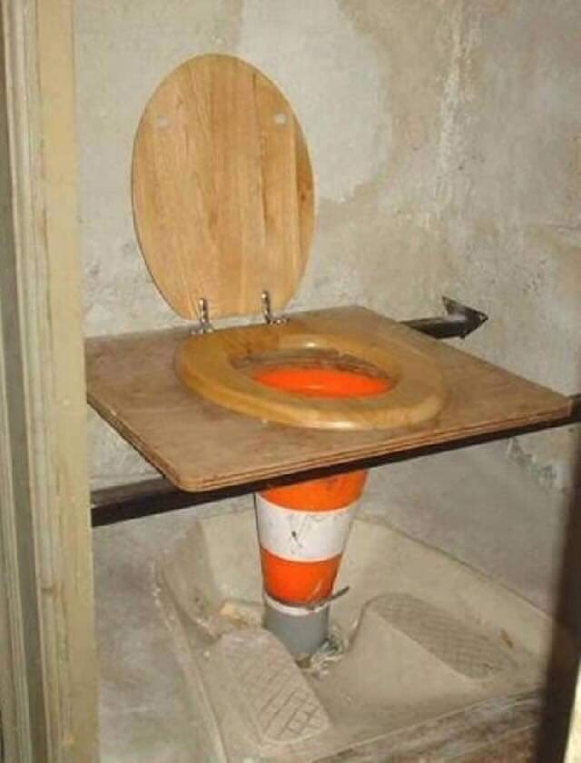 cursed_image - Wood stain toilet made from traffic cone