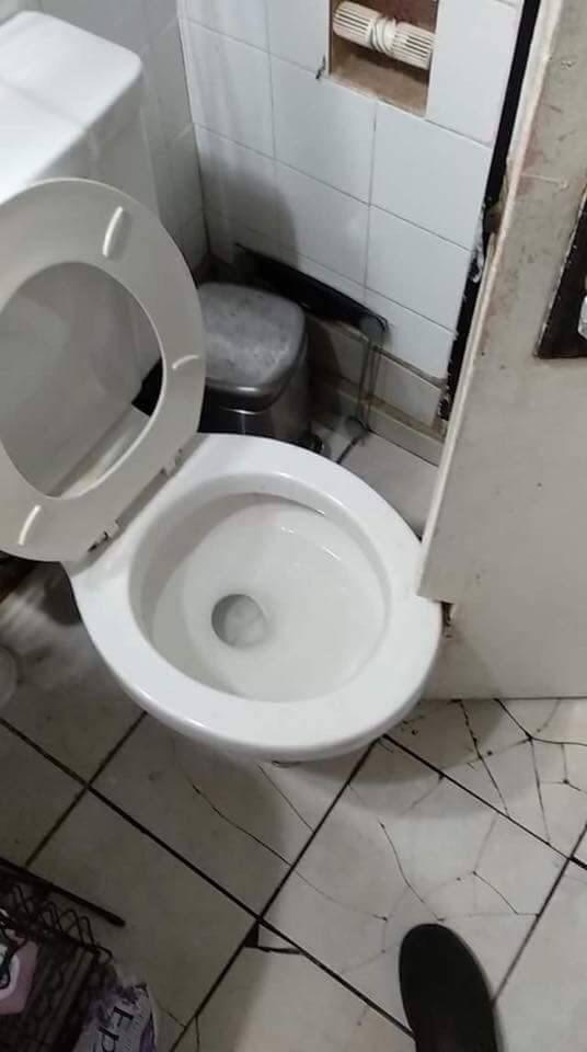 cursed_image - Toilet next to door