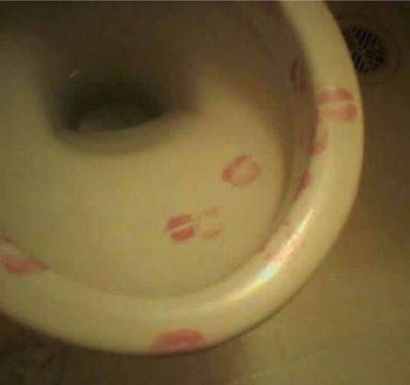 cursed_image-toilet covered in lipstick kisses