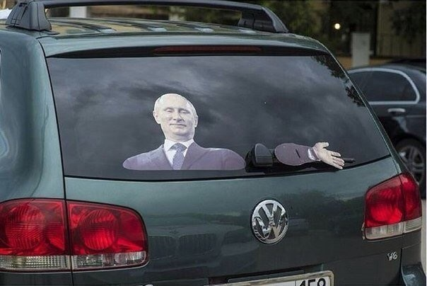 Car with putin and windshield wipers look like his hand