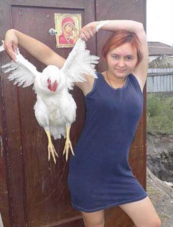 woman holding a chicken