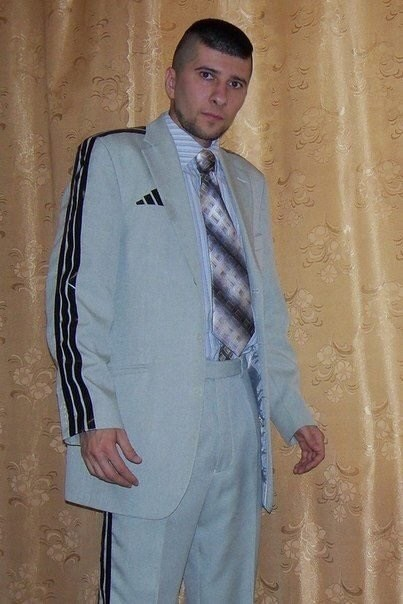 man wearing a suit with tracksuit lines on it