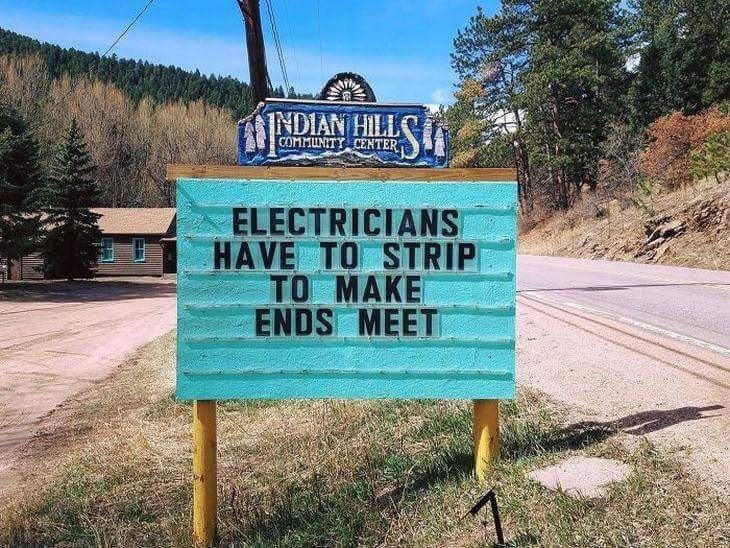 Street sign - INDIAN HIIL COMMUNITY CENTER ELECTRICIANS HAVE TO STRIP TO MAKE ENDS MEET
