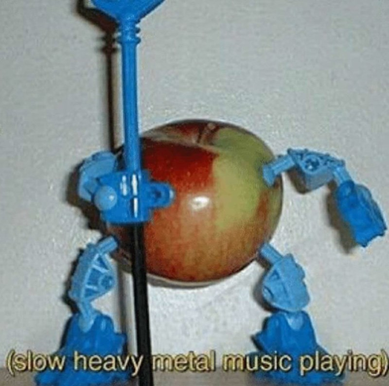 apple with toy robot arms and legs (slow heavy metal music playing)