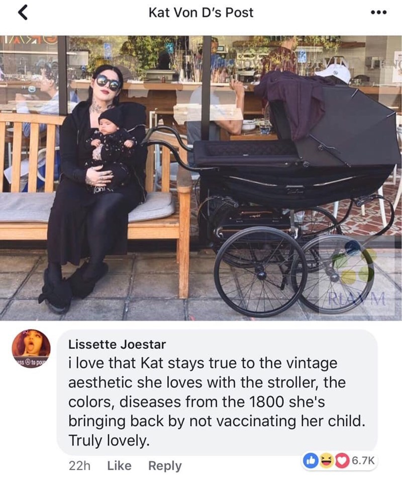 picture of woman in black next to old fashioned stroller i love that kat stays true to the vintage aesthetic she loves with the stroller, the colors, diseases from the 1800 she's bringing back by not vaccinating her child. Truly lovely.