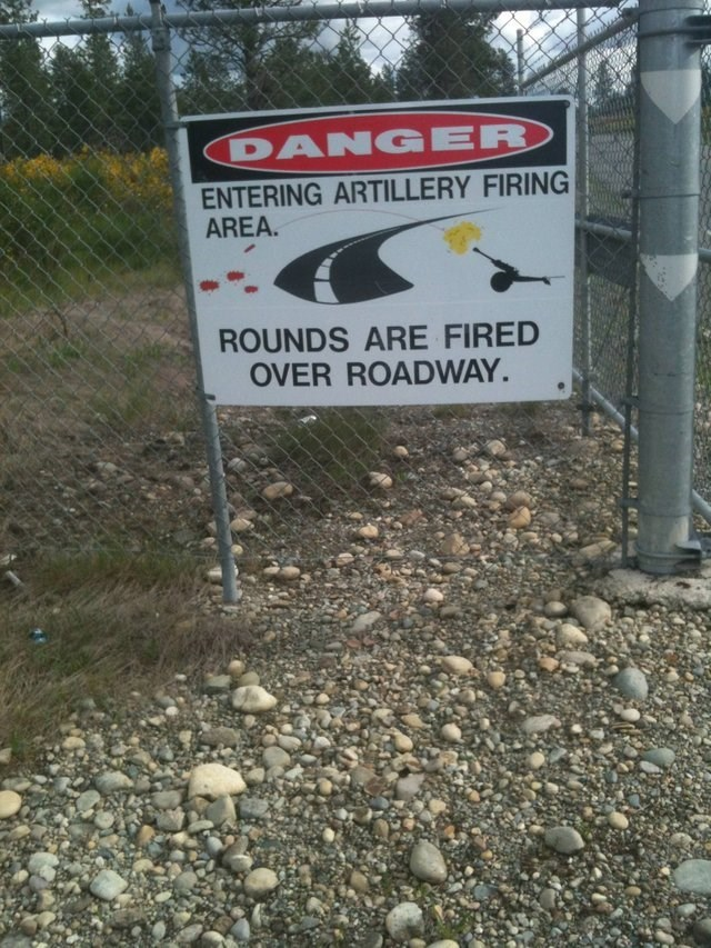 Signage - DANGER ENTERING ARTILLERY FIRING AREA. ROUNDS ARE FIRED OVER ROADWAY