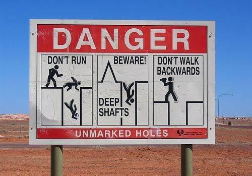Sign - DANGER DON'T RUN BEWARE! DON'T WALK BACKWARDS DEEP SHAFTS UNMARKED HOLES