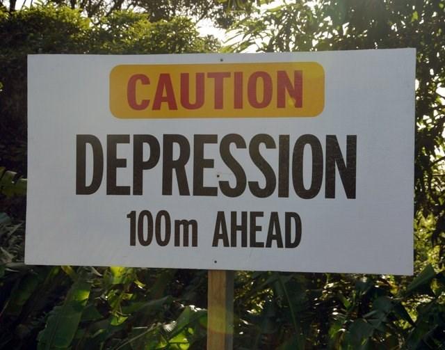 Street sign - CAUTION DEPRESSION 100m AHEAD
