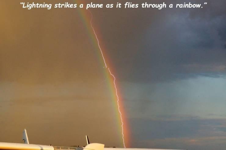"Rainbow - ""Lightning strikes a plane as it flies through a rainbow."""