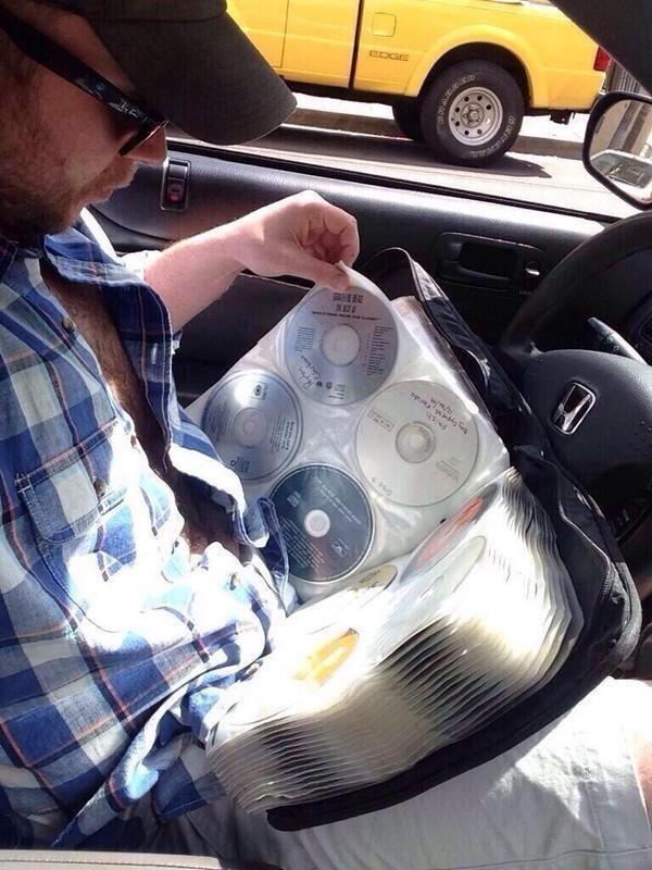 pic of a man flipping through a cd storage binder