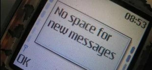 """Pic of an old cell phone with a pop-up message that reads, """"No space for new messages"""""""