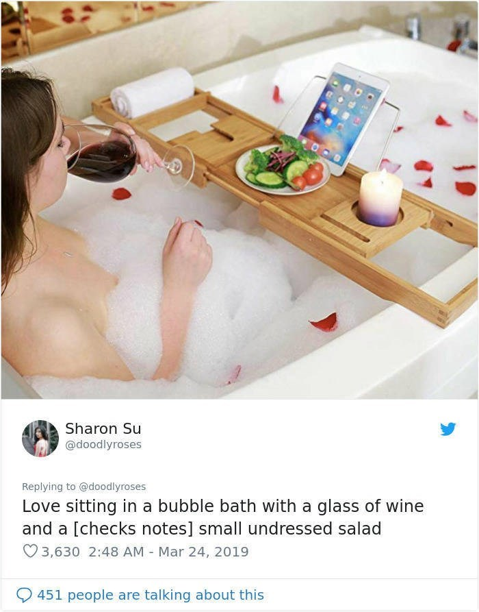 twitter post Love sitting in a bubble bath with a glass of wine and a [checks notes] small undressed salad woman in bath with tray wine salad and ipad